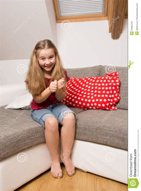 little girl couches portrait of excited little girl royalty free stock photo