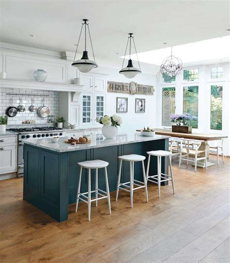 Island In A Kitchen | charming ikea kitchen design idea features unique white bar stools and marble top island and