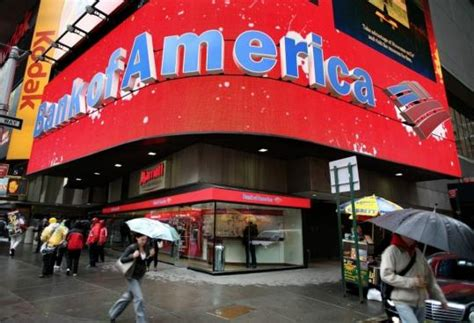 bank of america buys merrill lynch bank of america to cut up to 35 000 the boston globe