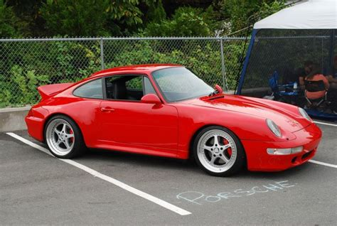 guards red porsche guards red porsche 993 carrera 4s with duckbill on techart