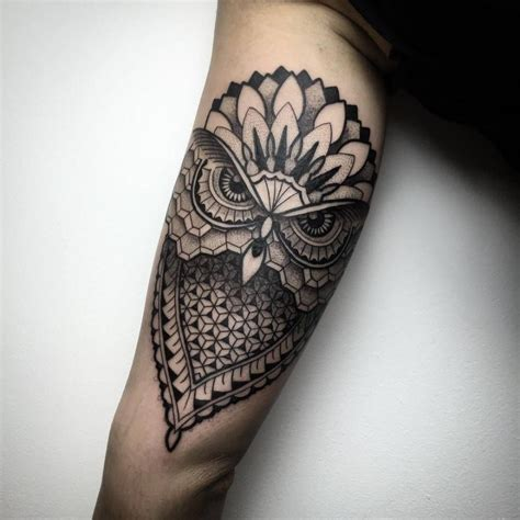 electronic inspired blackwork sleeve tattoo geometric blackwork style owl on the left inner arm