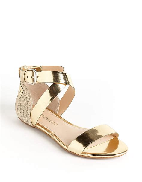 enzo angiolini sandals lyst enzo angiolini katira strappy sandals in metallic