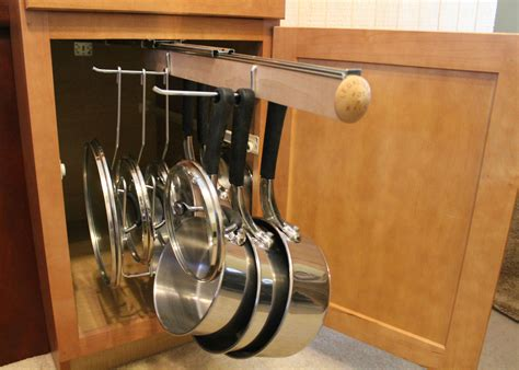 hanging pot rack in cabinet pull out under cabinet hanging pot and pan lid rack