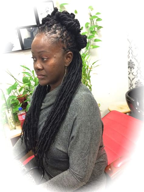 permanent for long hair near 14467 long mid back dread extensions done on black hair