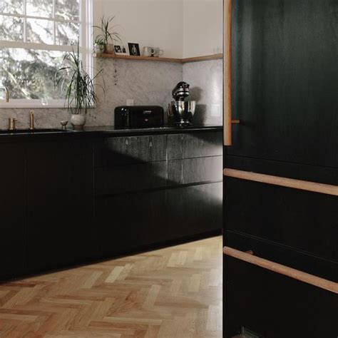 kitchen remodel ebonized ash cabinetry honed absolute
