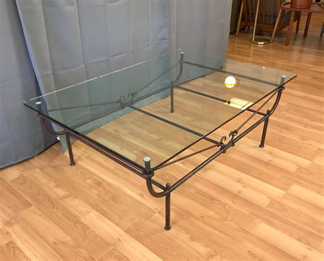 table cradle giacometti style wrought iron and glass cradle coffee