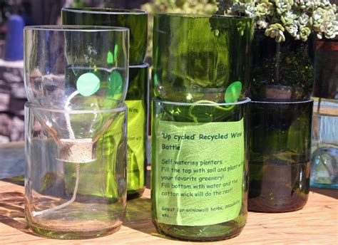 self watering reclaimed wine bottle planter green with by
