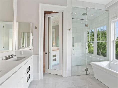 bathtub shower doors with mirror water closet with mirrored door transitional bathroom