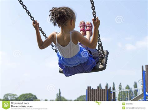 swing a little more child on swing royalty free stock photography image
