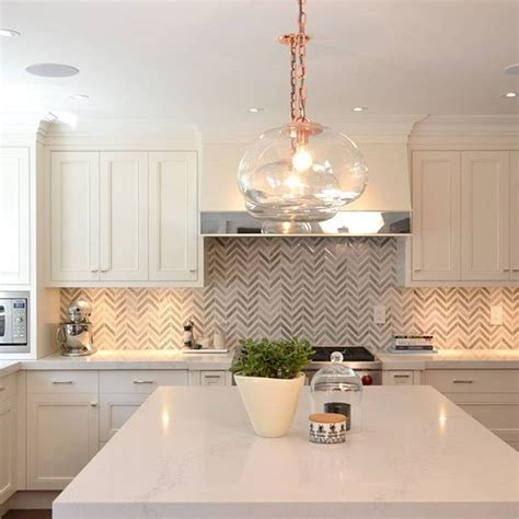 Herringbone backsplash, rose gold accents and a Frosty