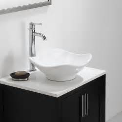 White bathroom sink with chrome legs faucets cabinet cabinets vanity