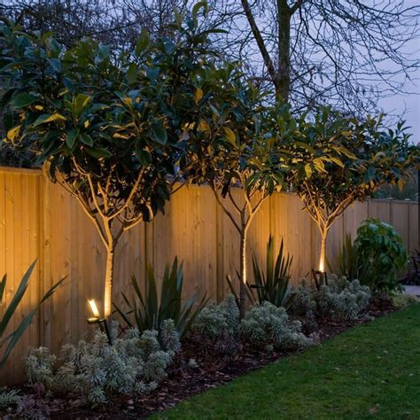 how to put christmas lights on shrubs 15 superb garden fence lighting ideas