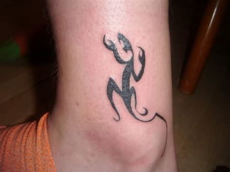 tribal tattoo on ankle tribal lizard on ankle