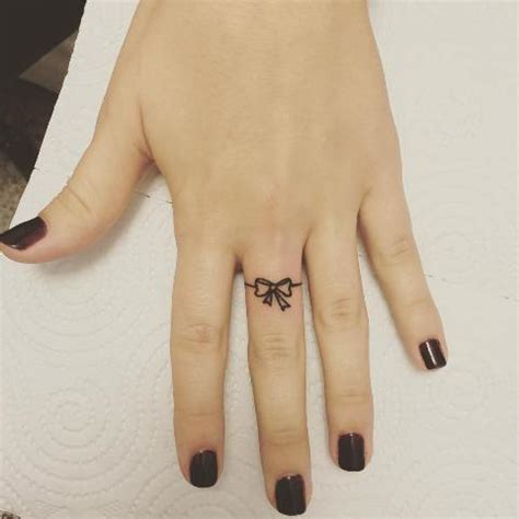 bow finger tattoo 21 small bow ideas to repeat styleoholic