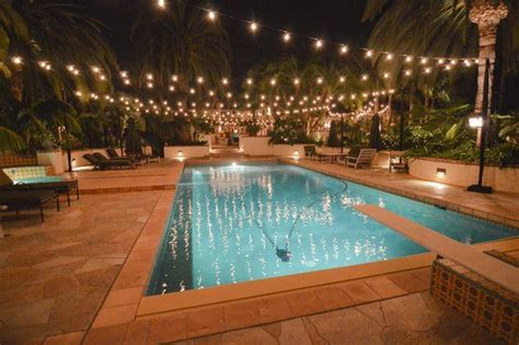 how to light up a backyard party string lights in the backyard over the pool will help with