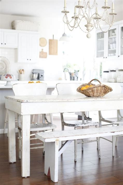 white distressed rustic dining table beaded chandelier