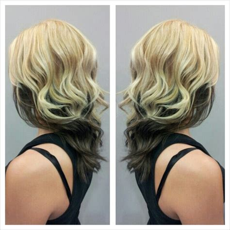 chunky highlights with a partial shave partial blonde highlight with an all over blonde color and