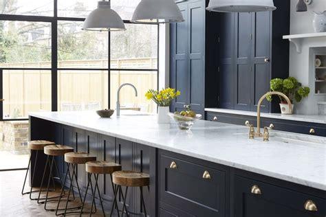 Vintage Navy Kitchen Design With Brass Hardware   DigsDigs
