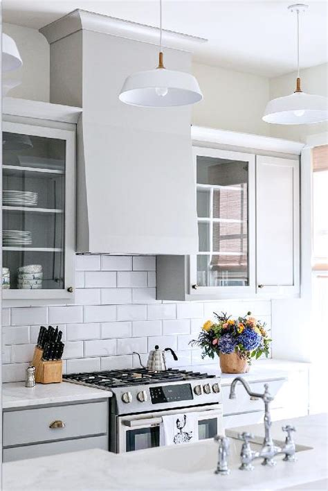 gray ikea kitchen cabinets with white beveled subway tile gray kitchen cabinets with dark nickel cup pulls and white