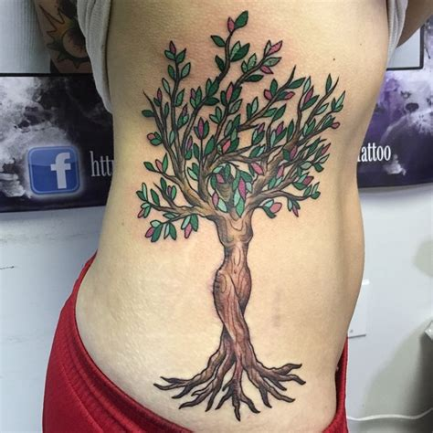 interesting woman shaped colored fantasy tree tattoo on