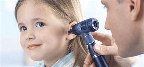 ear examination with otoscope pocketscope otoscope with throat illuminator