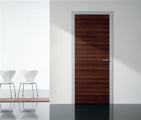 Modern Interior Swing Door Featuring A Wood Slab Panel Modern Interior Doors With Glass