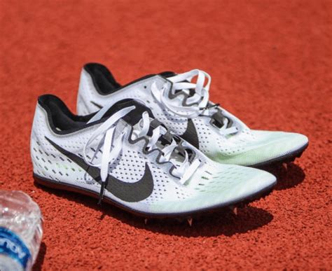 Nike Flywire 50 Hitam nike zoom victory 3 spikes run reporter