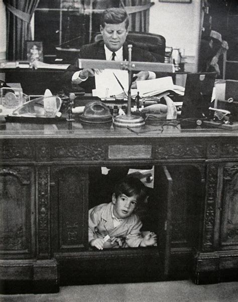 jfk s son john f kennedy jr playing in the resolute desk