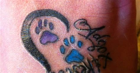 animal rescue tattoo ideas my first tatoo is says quot adopt rescue quot with paw prints