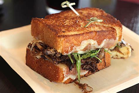 short rib sandwich short rib caramelized onion and vermont cheddar sandwich