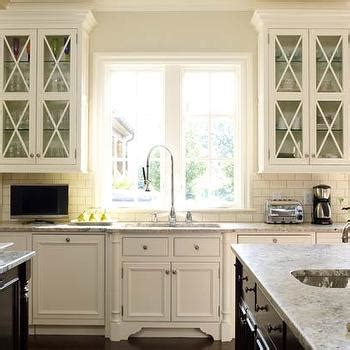 glass front kitchen cabinet cream cabinets transitional kitchen