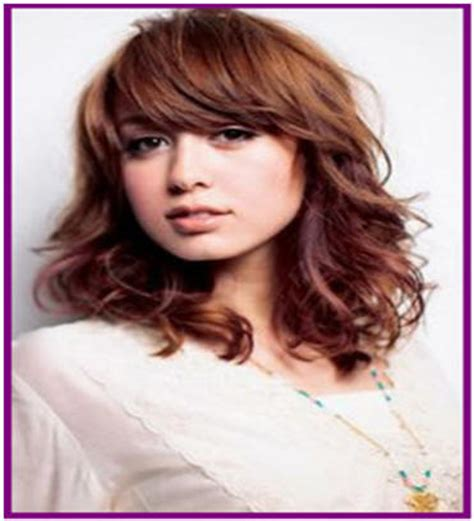 medium length tapered or layered hairstyles for 50 tapered curly hair with bangs shoulder length hairstyles