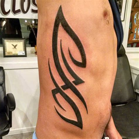 tribal rib tattoos 23 interesting tribal rib tattoos and designs