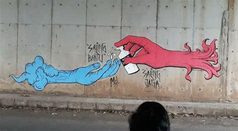 pesan kritik seniman mural tentang pandemi paradigma bangsa