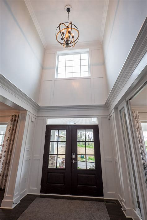 foyer lighting window and a orbital light fixture brighten the 2 story