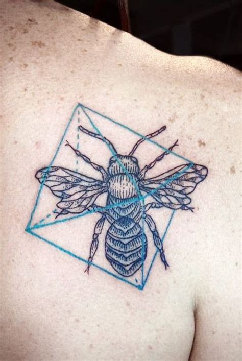 geometric tattoo book bug and geometric symbols tattoo on shoulder blade
