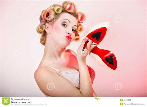 Heels Valent In in curlers with shoes royalty free