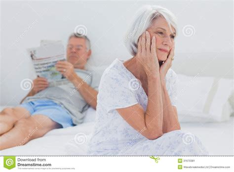 granny bed anxious mature woman sitting on bed stock image image 31670381