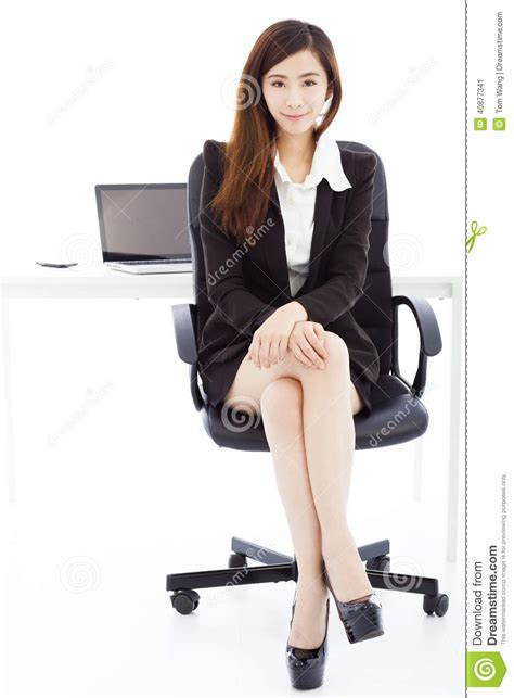 young confident business woman sitting   office stock photo image