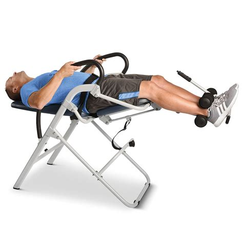 inversion therapy using chairs the easiest use inversion chair hammacher schlemmer