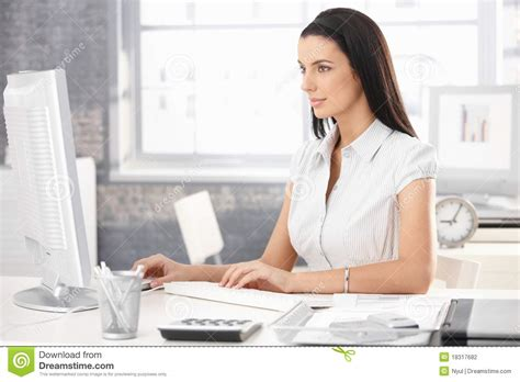 Office Worker At Desk Pretty Office Worker At Desk Stock Photography Image 18317682
