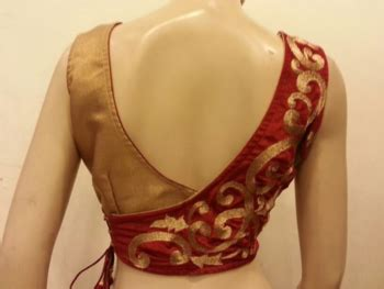 Buy stunning maroon velvet and golden blouse. Online