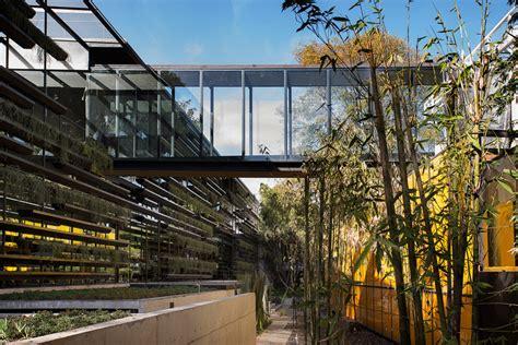 designboom rojkind rojkind arquitectos surrounds falc 243 n hq with modular planters