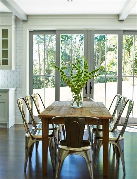 Colorful Kitchen Canisters metal dining chairs dining room eclectic with beige walls
