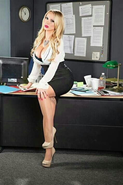 secretary bent over her desk the office girl stockings tight blouse cleavage meet