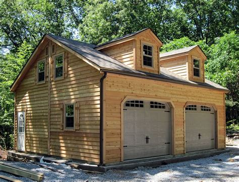 how to build a two story garage 24x28 2 car 2 story garage with cedar siding and dormers