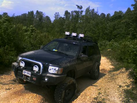 lifted nissan pathfinder 2004 pathfinder lift pirate4x4 com 4x4 and off road