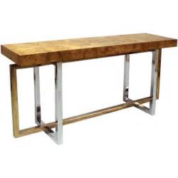 a burled wood console table with a chrome base