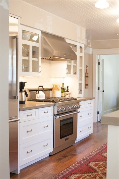 Kitchen Designers Vancouver help with soffits and hood wall design