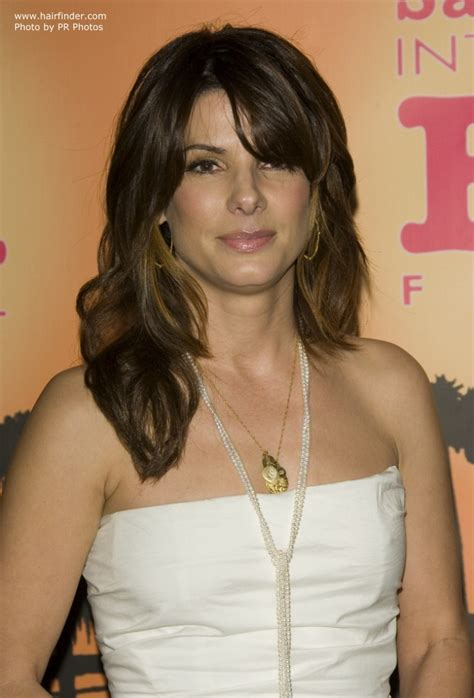 hairstyle covering one eye crossword sandra bullock with her hair styled in long layers and